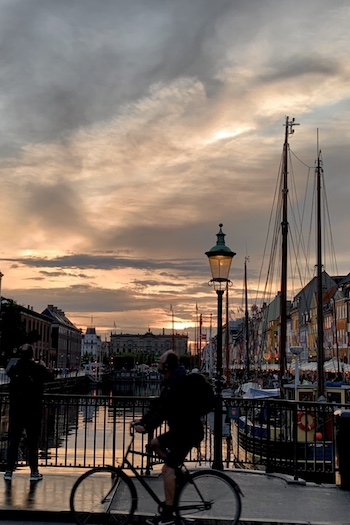 One of the most popular spots in the city is Nyhavn - the central harbor of the Danish capital. Here you can see beautiful and colorful houses along the water and old boots. At night you will have an amazing sunset and everywhere are fairy lights for an amazing atmosphere.