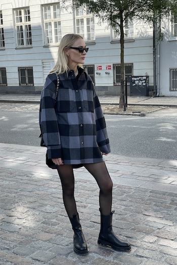 Fashion Street Style Shooting at Copenhagen Nyhavn with the Danish fashion Influencer Marie Hindkaer. She wears the new Boot CPH1000 in vitello black with a clear transparent sole and combined it with an oversized check Shirt.