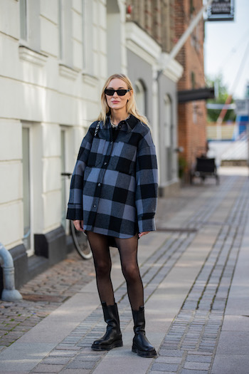 @mariehindkaer on the streets of copenhagen. She is wearing CPH1000 vitello black/clear, tights, a shirt blouse with checkered pattern and cool black sunglasses.