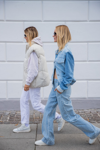 @alessawinter and @mariehindkaer on the streets of copenhagen. @alessawinter wears a all white look with CPH201 and @mariehindkaer the full denim look from head to toe with CPH461. They walk cool across the sidewalk with their sunglasses on.